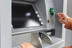 Man inserting his card into an atm