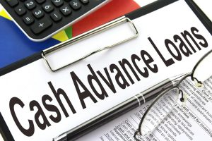 cash advance loans printed on a sheet of paper that is inserted into a clip board